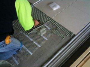 Укладка тёплого пола в плиточный клей